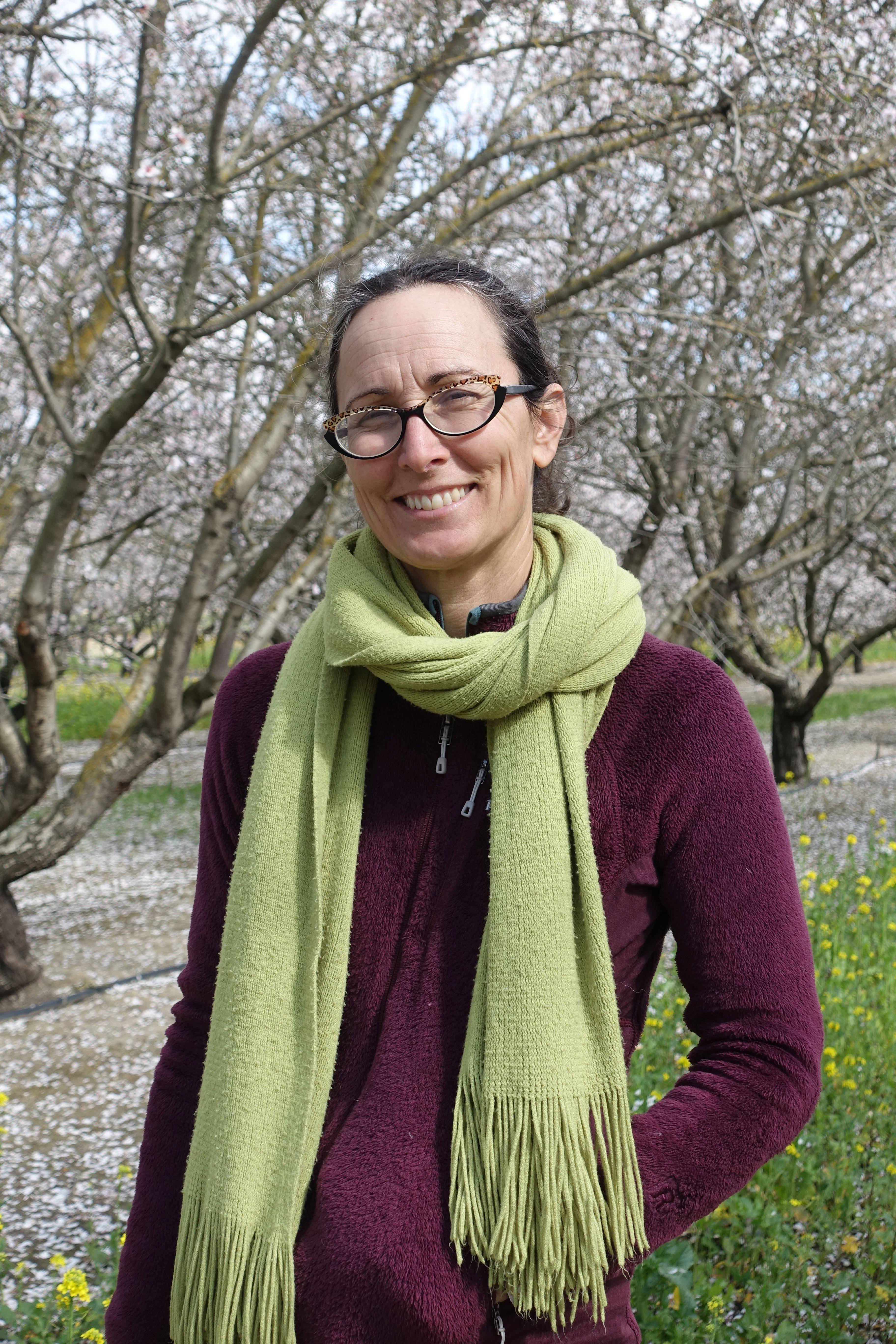 Christine Gemperle stands in her almond orchard